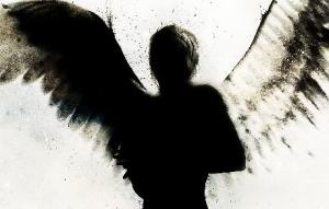Angel with light and dark wings representing the Yin Yang nature of Jung's shadow